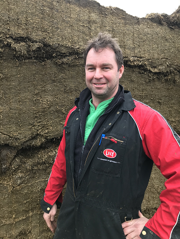 Andrew Dale in front of the lucerne silage
